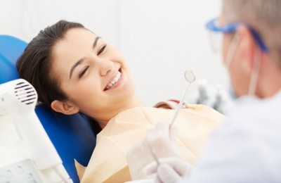 young woman receiving dental check up
